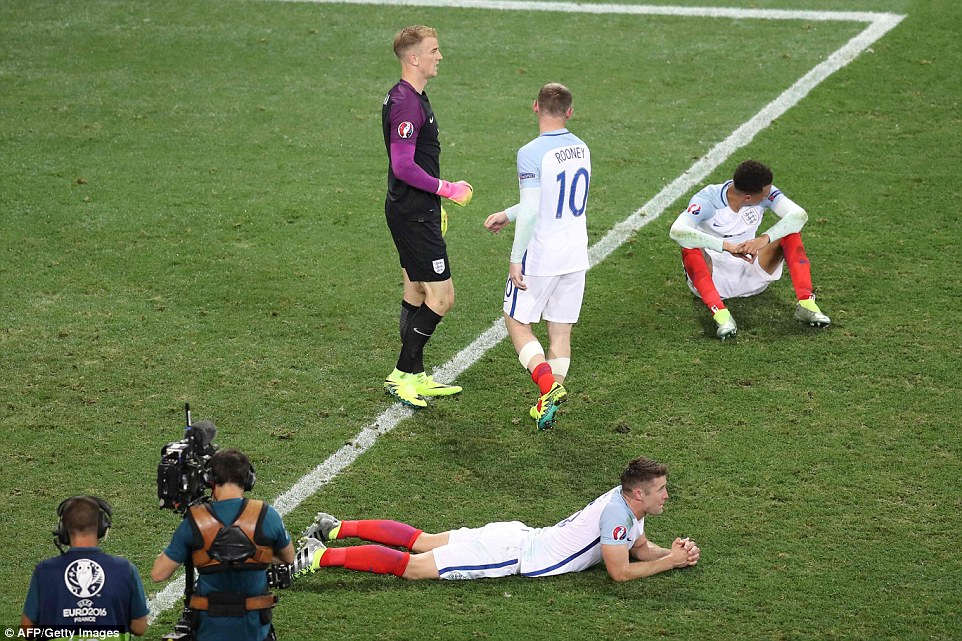 England stars Joe Hart, Wayne Rooney, Gary Cahill and Dele Alli look saddened after the Three Lions fell to a shock defeat