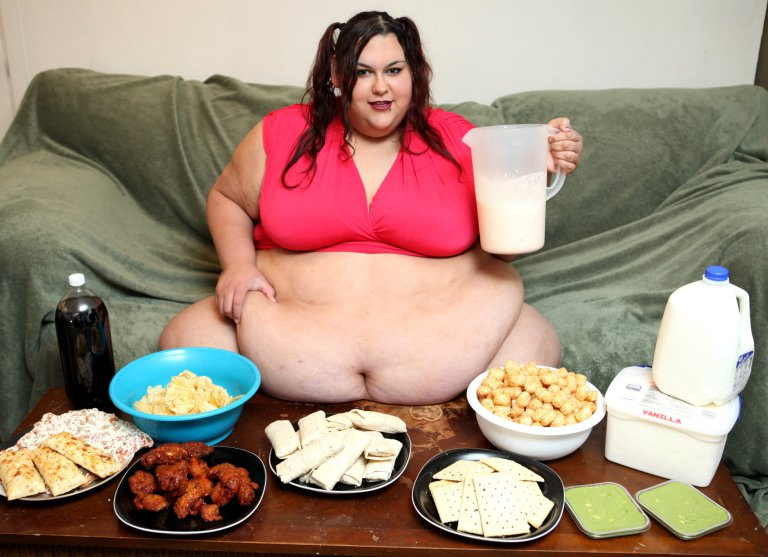 *** EXCLUSIVE - VIDEO AVAILABLE*** Monica preparing to funnel feed on August 21, 2016, in Fort Worth, Texas. Morbidly obese Monica Riley tips the scales at a whopping 50 stone. But rather than trying to lose weight, the 27-year-old, from Fort Worth, Texas, wants to continue to pile on the pounds ñ to the point where she is completely immobile. Monica, who models on Super Sized Big Beautiful Woman websites, is aiming to become the fattest woman in the world at 1000lbs ñ and wants to be so huge that she is literally bed-bound. Her feeder boyfriend, Sid Riley, 25, spends his days cooking for Monica, rolling her over when her 91-inch stomach is full and funnel feeding her through a tube. PHOTOGRAPH BY Ruaridh Connellan / Barcroft Images London-T:+44 207 033 1031 E:hello@barcroftmedia.com New York-T:+1 212 796 2458 E:hello@barcroftusa.com New Delhi-T:+91 11 4053 2429 E:hello@barcroftindia.com www.barcroftimages.com